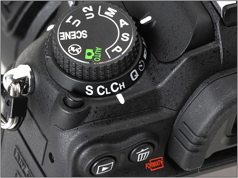 The D7000's mode dial hides the scene modes to stop serious shooters from barfing